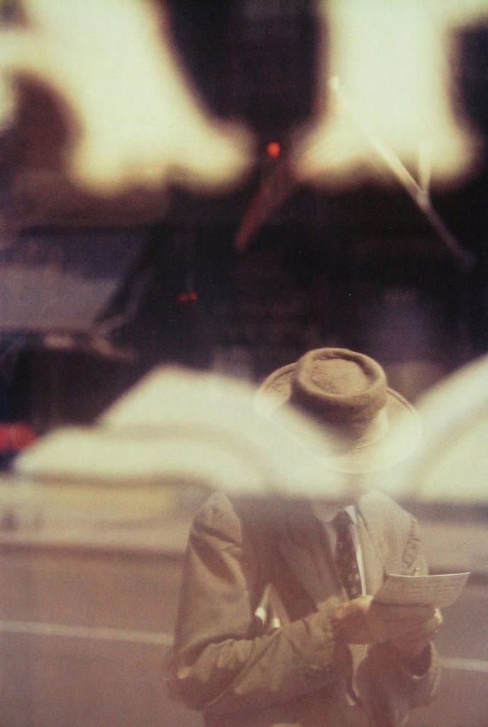 Saul Leiter - Man Reading - 1957